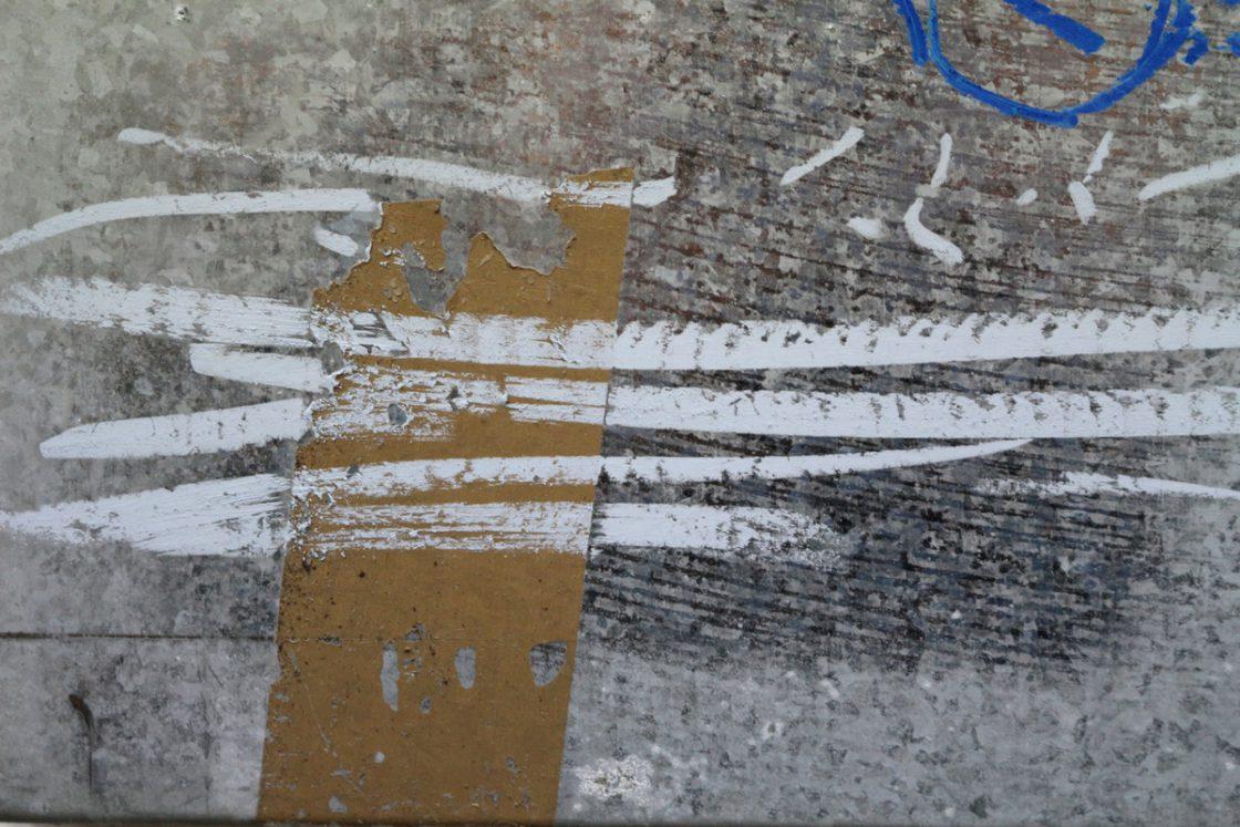 Detaljer af oliekridttegninger på stål
